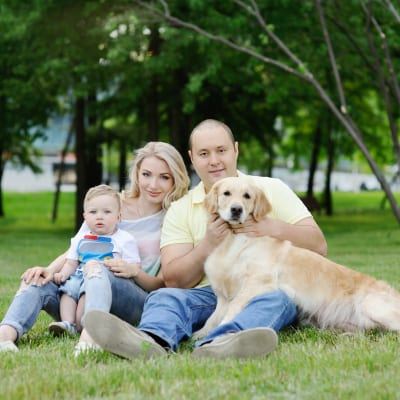 Family with dog - Positive Reinforcement Dog Training