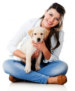 Woman sitting with puppy - pet resources